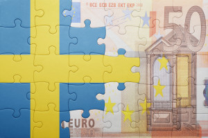 puzzle with the national flag of sweden and euro banknote
